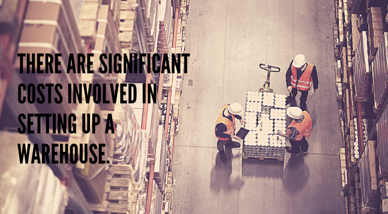 A fulfillment warehouse with three workers. There are many costs in setting up a warehouse.